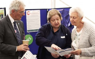 Dementia specialists chat to a visitor about their research - Salford Royal Research Week, September 2014